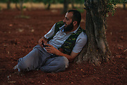 Regional chief-commander of the Free Syrian Army (FSA) Abdulkadir Alsalih (known as Haji Marea) is seen taking a shelter under an olive tree during a military operation in Minaq (Menagh) military airport on Friday, Jun 29, 2012. (Photo by Vudi Xhymshiti)