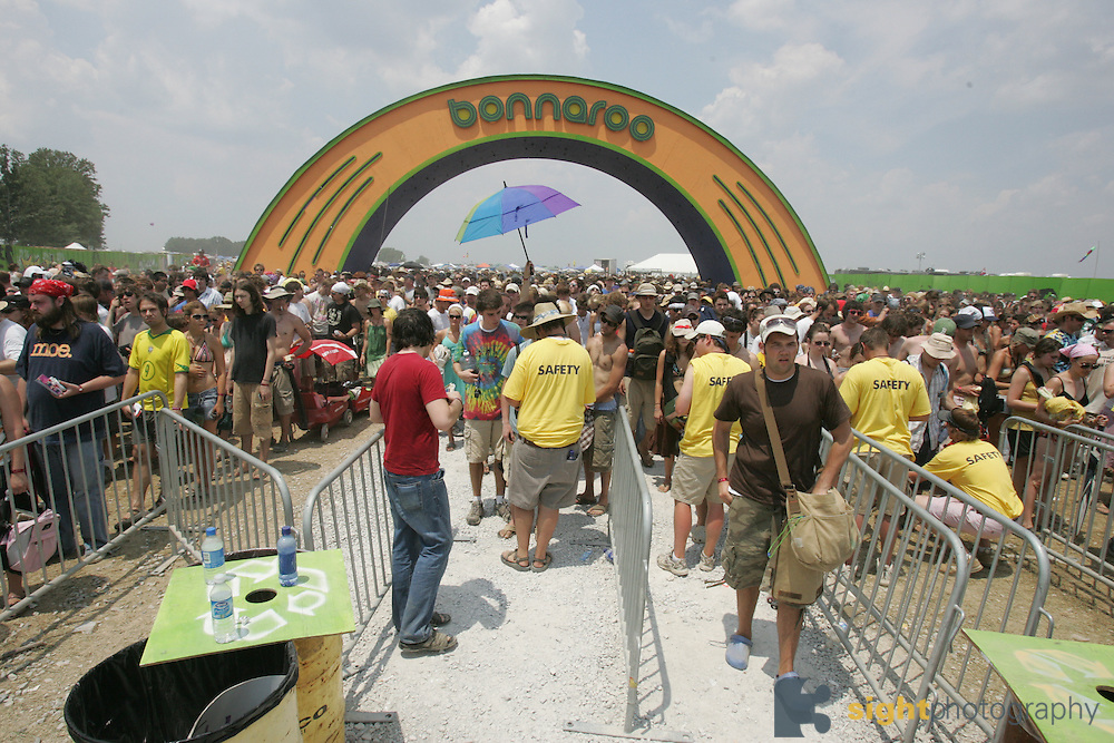 Crowds enter through security into the main concert field on the second day of the 2007 Bonnaroo Music & Arts Festival on June 15, 2006 in Manchester, Tennessee. The four-day music festival features a variety of musical acts, arts and comedians..Photo by Bryan Rinnert
