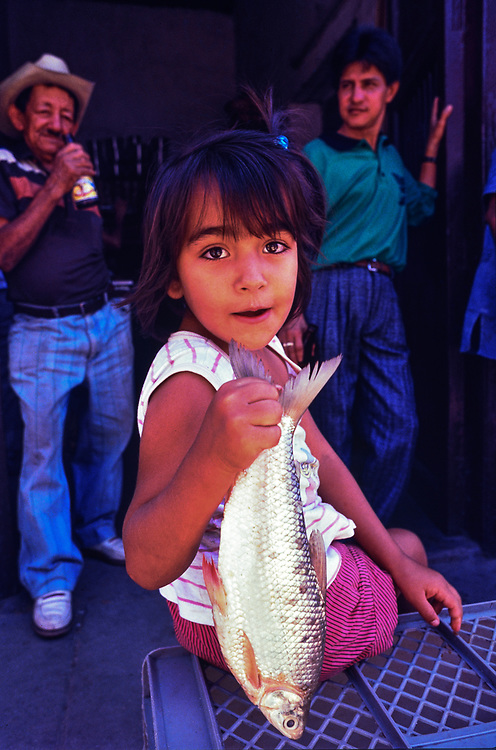 Young Colombian girl helping her mother sell fish Barranquilla,Caribbean Coast, Colombia