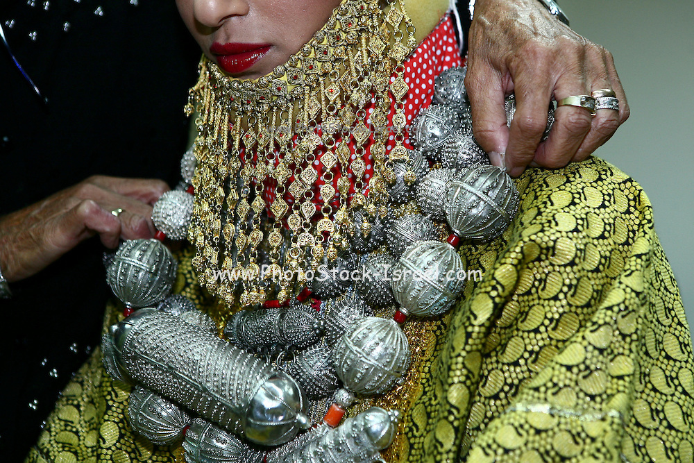 Traditional jewelry for the bride to wear at the Henna ceremony. Henna celebration is a traditional Mideastern Jewish ceremony the couple attends one week befor they get married. During the ceremony they wear traditional clothes and jewelry, dance and apply henna paste to the skin for good luck.