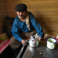 A gaucho brews mate tea in Torres del Paine National Park, Patagonia, Chile.