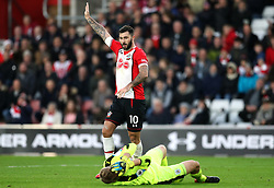 Southampton's Charlie Austin signals whilst Huddersfield Town goalkeeper Jonas Lossl lies injured on the pitch during the Premier League match at St Mary's, Southampton.