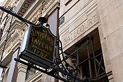 A sign post for the Simpsons Tavern pub on the 19th September 2019 in London in the United Kingdom. The Simpsons Tavern is a traditional chop house restaurant dating back to 1757, with wood-panelled stalls for traditional breakfasts and lunches.