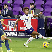 ORLANDO, FL - JANUARY 22:  Crystal Dunn #19 of United States kicks the ball against Columbia at Exploria Stadium on January 22, 2021 in Orlando, Florida. (Photo by Alex Menendez/Getty Images) *** Local Caption *** Crystal Dunn