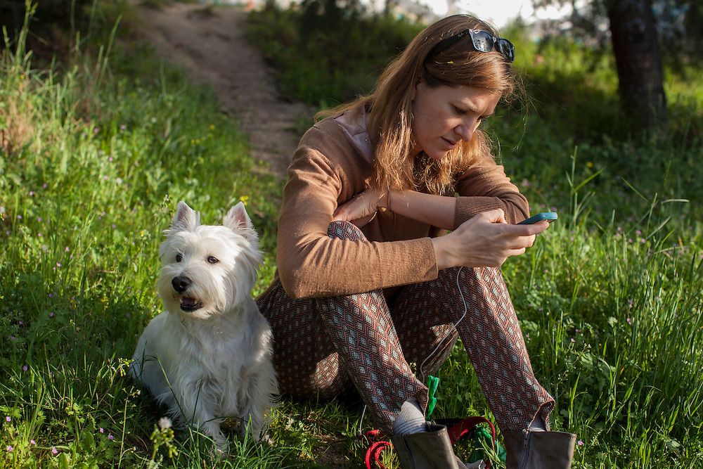 Young woman with her westie dog in Madrid, Spain.