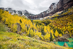 Autumn color in Teluride Canyon.  Bridal Vail Falls can be seen at the top, and perhaps the prettiest mining tailing pond at the bottom.  Golden aspens blanket much of the Colorado Rockies, Teluride Canyon is a fine example.