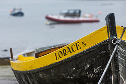 Boat in harbor at low tide, Kinvarra, County Galway, Ireland
