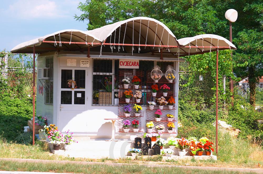 A small shop selling flowers next to the church yard. Trebinje. Republika Srpska. Bosnia Herzegovina, Europe.