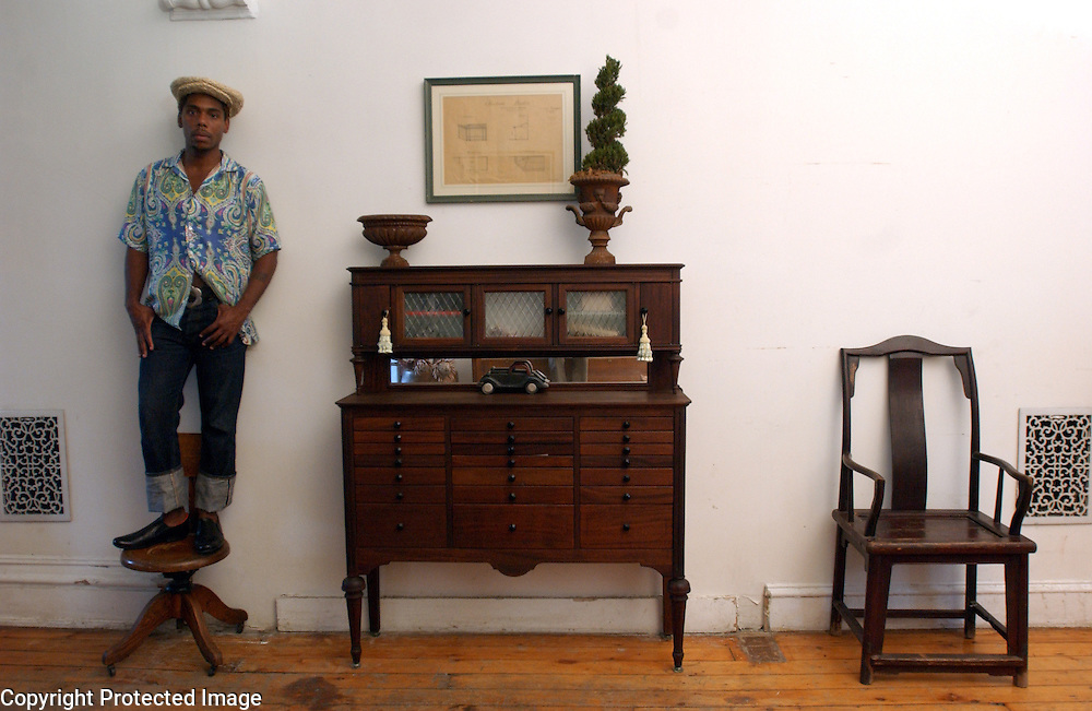 The multi-talented Carl Hancock Rux is seen in his home in Brooklyn, NY. 8/4/2004 Photo by Jennifer S. Altman