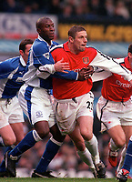 Ex Arsenal Player Kevin Campbell (Everton) takes a firm grip of Oleg Luzhny (Arsenal) Everton v Arsenal. 18/11/2000.FA Premiership. Credit: Andrew Cowie / Colorsport.