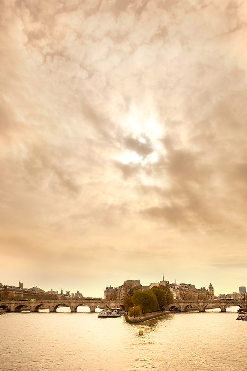 Sky with rising sun over Ile de la Cite, Seine River, Paris, France