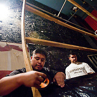 101112       Cable Hoover<br /> <br /> Greg Santiago, left, and Aaron Baca construct a vortex tunnel for a haunted house at the Rio West Mall Thursday.