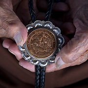 Navajo Code Talker Sam Sandoval holds a replica of his Congressional Silver Medal, July 7, 2019, Shiprock, New Mexico.
