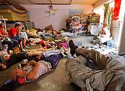 "in this file photo, taken on March 30th, 2012 central american migrants watch a movie in the dormitory in ""San Juan Diego Cuauhtlatoatzin"" shelter  in Lechería, Estado de México. (Photo: Prometeo Lucero)"