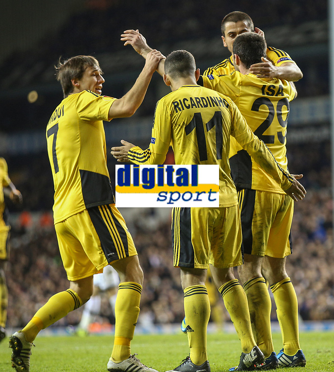 Football - 2013 / 2014 Europa League - Tottenham vs. Sheriff Tiraspol<br /> <br /> Ismail Isa of Sheriff Tiraspol is congratulated by team mates after scoring at White Hart Lane Stadium.<br /> <br /> COLORSPORT/DANIEL BEARHAM
