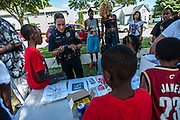 MILWAUKEE, WI -- 8/11/15 -- Milwaukee Police Community Liaison Officer Ofc. Tracey Geniesse works with neighborhood children during the dedication of Tracolli Peace Park. Named after Tracolli Surveyor, gunned down December 10, 2014 a block from his house as he walked a family friend home from school. The park was dedicated to peace in his memory. Tracolli was set to graduate this spring and was to attend Ivy Tech in Indianapolis to study graphic designat Milwaukee leads the nation in most negative indicators of African-American social problems: educational achievement gaps, incarceration rates, unemployment and segregation…by André Chung #_AC26382