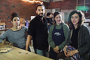 """Victorine Ariste-zelise, Aladdin Charni, Sandrine Ruiz et Gilia Bataille cofounders of the Freegan Pony Restaurant.<br /><br />The Freegan Pony is an alternative restaurant housed in a squat. It was founded in 2015 by Aladdin Charni with three other collaborators. The restaurant specialises in cheap vegetarian cuisine, serving meals which guests reserve a place through a Facebook group, paying €2 a meal. The restaurant meals contain unsold and donated food, collected from wholesellers at the Paris Rungis vegetable market. The Freegan Pony is located at the Porte de la Vilette on the outskirts of Paris, at the entrance to the peripherique outer circle motorway.<br /><br />Freegans are people who employ alternative strategies for living based on limited participation in the conventional economy and minimal consumption of resources. Freeganism is the practice of reclaiming and eating food that has been discarded. People who attempt to live an ethical lifestyle by reusing trash and rubbish thrown away by others.<br /><br />Freeganism is an ill-defined activity and is a subset of the larger anti-capitalist and environmental protest movements. It embraces alternative, anti-consumerist lifestyles. Freegan practices also include co-operative living, squatting and """"freecyling"""", or matching things that people want to get rid of with things other people need"""