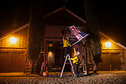 HEALDSBURG, CA - OCTOBER 27: Firefighters take down an American flag after helping people evacuate a home as winds bare down on Highway 128 during the Kincade Fire in Healdsburg, California, U.S. on Sunday October 27, 2019. Photographer: Philip Pacheco/Bloomberg