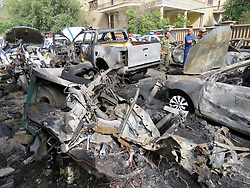 April 29, 2017 - Baghdad, Iraq - Iraqi security forces and civilians gather at the site of a suicide bombing in Karrada district of Baghdad, capital of Iraq. At least five people were killed and ten others wounded Friday evening in a bomb attack in the downtown Karada district of Baghdad, according to local police.  (Credit Image: © Khalil Dawood/Xinhua via ZUMA Wire)