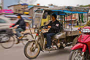 Vietnamese veteran Nguyen Van Thuan makes a delivery on his motorized cart in Hanoi, Vietnam. (Nguyen Van Thuan is featured in the book What I Eat: Around the World in 80 Diets.) MODEL RELEASED.