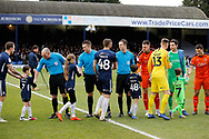 Players and match officials shake hands before the EFL Sky Bet League 1 match between Southend United and Luton Town at Roots Hall, Southend, England on 26 January 2019.
