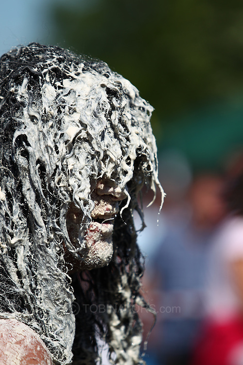 Coxheath, Kent - Saturday, May 22nd 2010: Joel Hicks of Leicester covered in custard during the World Custard Pie Championships at Coxheath near Maidstone, Kent. His team, The Modern Family, were eliminated in the semi-finals. The first championship was held in 1967 in Coxheath using a special custard recipe developed by Richard Hearn aka Mr Pastry. The championship is made up of teams competing in heats, semi finals and the final, with the number of pies available per team increasing from 5 in the heats to 10 in the final. 6 points are scored for a direct hit on the face, 3 points for the shoulders or upwards, 1 point for any other part of the body, and points are deducted for misses. A discretionary 5 points can be awarded for the most amusing and original throwing technique. The event is part of the Rotary Club funday. (Pic by Andrew Tobin/SLIK Images)