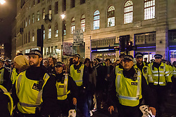"London, November 4th 2015. Police kettle and march a group of students after thousands marched through the capital as part of their ""fight for free education,"" protest against student debt as well as demanding ""an end to the scapegoating and deportation of international students."" The students were released after being marched to Charing Cross Station."