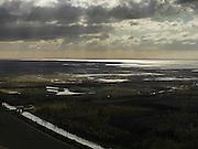 Nederland, Zuidelijk Flevoland, 16-04-2012; Oostvaardersplassen ter hoogte van Knardijk en Hollandse Hout. Amsterdam aan de horizon..Nature reserve Oostvaardersplassen. .luchtfoto (toeslag), aerial photo (additional fee required).foto/photo Siebe Swart
