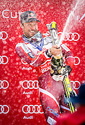 SHOT 12/4/15 1:03:45 PM - Norwegian skier Aksel Lund Svindal sprays the crowd with champagne after the awards ceremony at the 2015 Audi Birds of Prey Downhill at Beaver Creek Ski Resort in Beaver Creek, Co. Birds of Prey is the only men's Audi FIS Ski World Cup stop in the United States. Svindal won the event with a time of 1:42.34. (Photo by Marc Piscotty / © 2015)