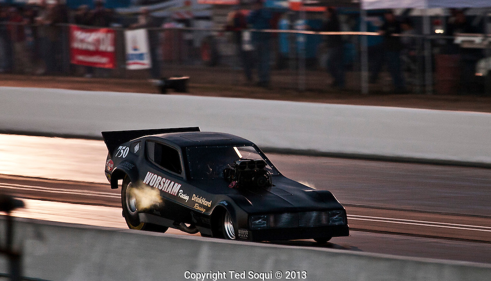 Del Worsham doing a night run in his funny car..The 2013 March Meet at the Auto Club Famoso Raceway in McFarland, CA.