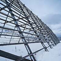 Empty cod drying racks in snow, Lofoten islands, Norway