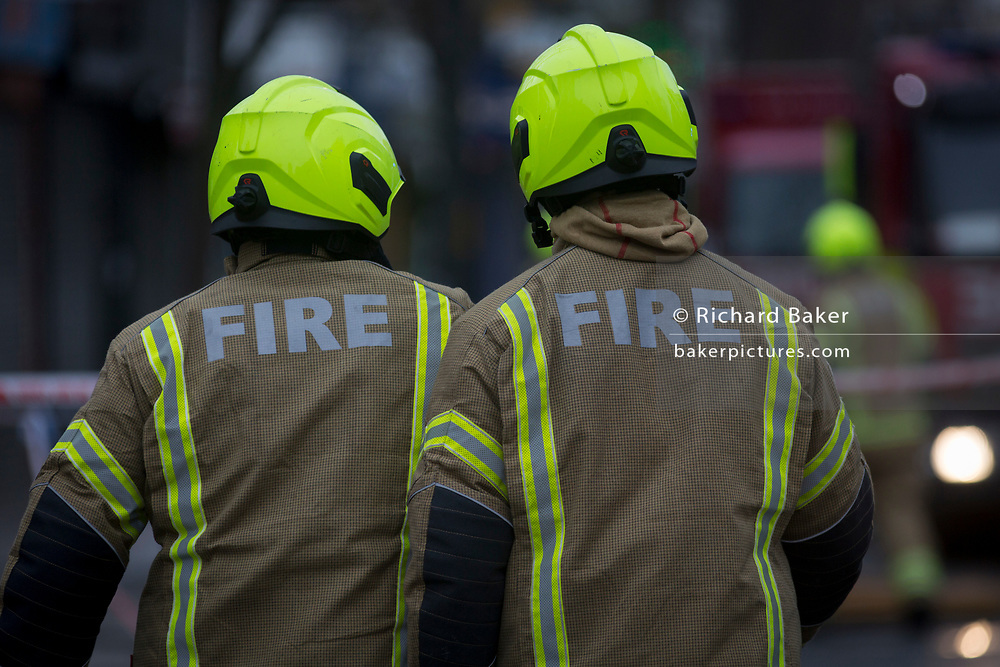 """Fire fighters attend a fire in premises on the Walworth Road, on 16th January 2019, in London, England. According to London Fire Brigade, """"Ten fire engines and around 70 firefighters were called to a fire at a shop with flats above on Walworth Road in Walworth. The ground floor of the building was destroyed by the blaze and a small part of the basement, first floor and second floor were also damaged. Firefighters wearing breathing apparatus rescued one man and one woman from a first floor flat roof using a short extension ladder. The woman was treated at the scene for smoke inhalation then taken to hospital by London Ambulance Service crews."""""""