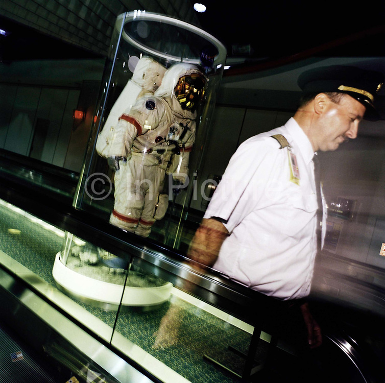 A moon-walking NASA astronaut model stands in the middle of two terminal escalators - as an airline pilot glides past at Miami International airport. As the state from where all the Apollo moonshots were launched at Cape Canaveral, Florida is proud of its space race heritage. Like US astronauts of that era, the airline pilot may be an ex-military aviator too now flying commercial aircraft from hubs like Miami and across the US.