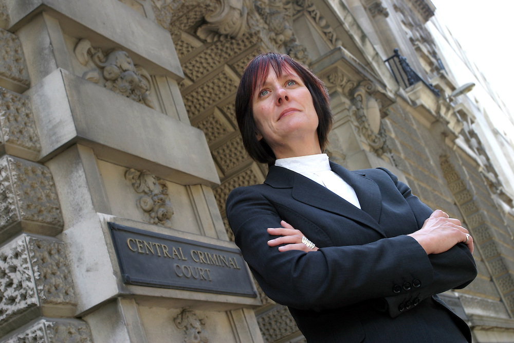 Female solicitor outside Criminal Law Courts, London
