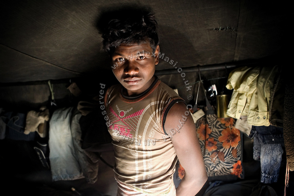 A labourer is portrayed inside his tent on the Leh-Manali Highway.