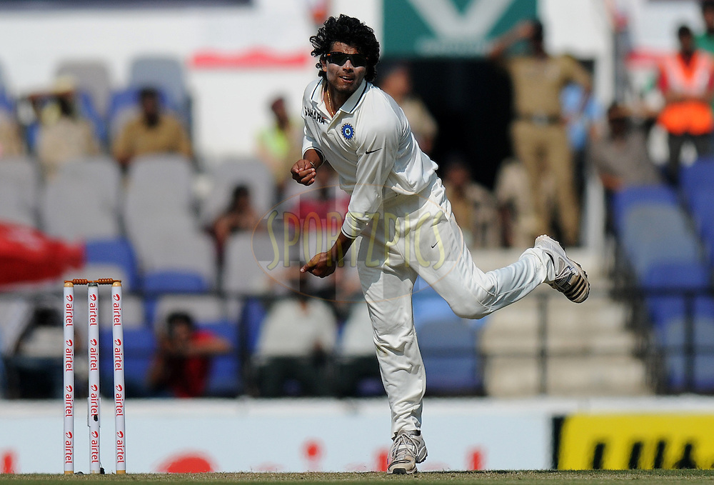 Ravindra Jadeja of India bowls during day one of the 4th Airtel Test Match between India and England held at VCA ground in Nagpur on the 13th December 2012..Photo by  Pal Pillai/BCCI/SPORTZPICS .