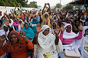 Ladies attending the first-ever international Conference on Womens' Challenge in Darfur, raise their hands in the hope of peace while gathering to hear speeches by the British peer Lord Ahmed and traditional songs by local singers just outside the compound walls belonging to the Governor of North Darfur in Al Fasher (also spelled, Al-Fashir) where the women from remote parts of Sudan gathered to discuss peace and political issues and celebrate Darfurian culture. The Sudanese Women General Union has 27,000 branches all over Sudan, including Darfur. They have representatives in all rural villages, across communities of around 80 tribes and clans. The women of Sudan are wives, mothers, farmers a real force and historically, there have been female leaders.