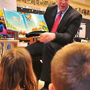 """3/2/10 -- BATH, Maine. Maine's District 19 Representative Seth Goodall (D-Richmond) came to Dike Newell Elementary in Bath on Tuesday morning to read to Wanda Brown's 1st grade class. Rep. Goodall read one of his mother's favorite books, """"Michael Recycle"""",  by Ellie Bethel. He spoke with the children about the work he's doing at the State House to improve recycling in Maine. Many of the children were well-versed in recycling efforts and had good questions for the District 19 rep. Photo by Roger S. Duncan"""