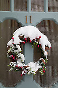 Snow covered Christmas wreath in Kings Heath after heavy snow fall on Sunday 10th December 2017 in Birmingham, United Kingdom. Deep snow arrived in much of the UK, closing roads and making driving treacherous, while many people simply enjoyed the weather.