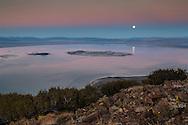 Full moon rising over Mono Lake in the evening; Mono County; Eastern Sierra; California