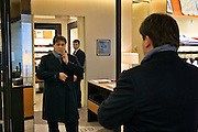 Moscow, Russia, 04/03/2006.&#xA;A salesman wtches a young marketing executive as he tries on clothing in the Zeynoi menswear store, part of the central Moscow complex of luxury stores controlled by the Russian Mercury Group.<br />