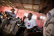 Members of the band King's Jubilee, Richard Neufville (right) and Zaroe Amilcar, sing during a jamming session with Canadian artist Dave Bidini (left)  at the  Buduburam refugee settlement, roughly 20 km west of Ghana's capital Accra on Friday April 13, 2007. The group, which is composed of five Liberian men living at Buduburam, is currently recording their second album, and already has a growing number of fans back in Liberia. The Buduburam refugee settlement is still home over 30,000 Liberians, most of which have mixed feelings about returning to Liberia..