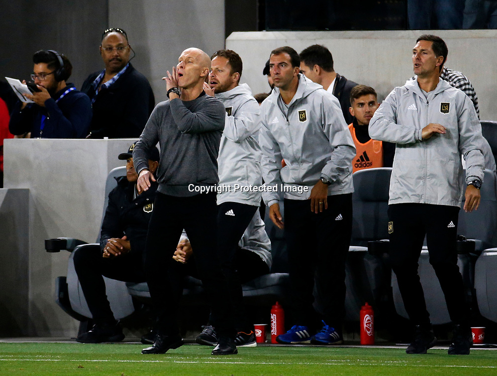 Los Angeles FC head coach Bob Bradley directs his team against Seattle Sounders in the second half of an MLS soccer game at Banc of California Stadium in Los Angeles, Sunday, April 29, 2018. The Los Angeles FC won 1-0. (AP Photo/Ringo H.W. Chiu)