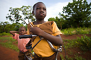 """Emanuel Nyanibo, 10, and her five-year-old brother ride Emanuel's bike to school near Savelugu, northern Ghana, on Monday June 4, 2007. """"My father bought me a bike in order for me to keep going to school,"""" says Emanuel. """"He told me you have to keep going to school so that you can become president of Ghana one day."""""""