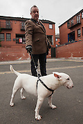 A local neighbour walks his English terrier from the Northern quarter in Manchester, UK.