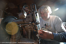 Frank Westfall working on Paul Ousey's saddle bags in an old leather shop at the Old Town Museum in Burlington, Colorado for the hosted dinner stop during Stage 8 of the Motorcycle Cannonball Cross-Country Endurance Run, which on this day ran from Junction City, KS to Burlington, CO., USA. Saturday, September 13, 2014.  Photography ©2014 Michael Lichter.