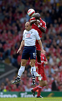 Photo: Jed Wee.<br />Liverpool v Tottenham Hotspur. The Barclays Premiership. 23/09/2006.<br /><br />Liverpool's Momo Sissoko (R) wins a header from Tottenham's Danny Murphy.