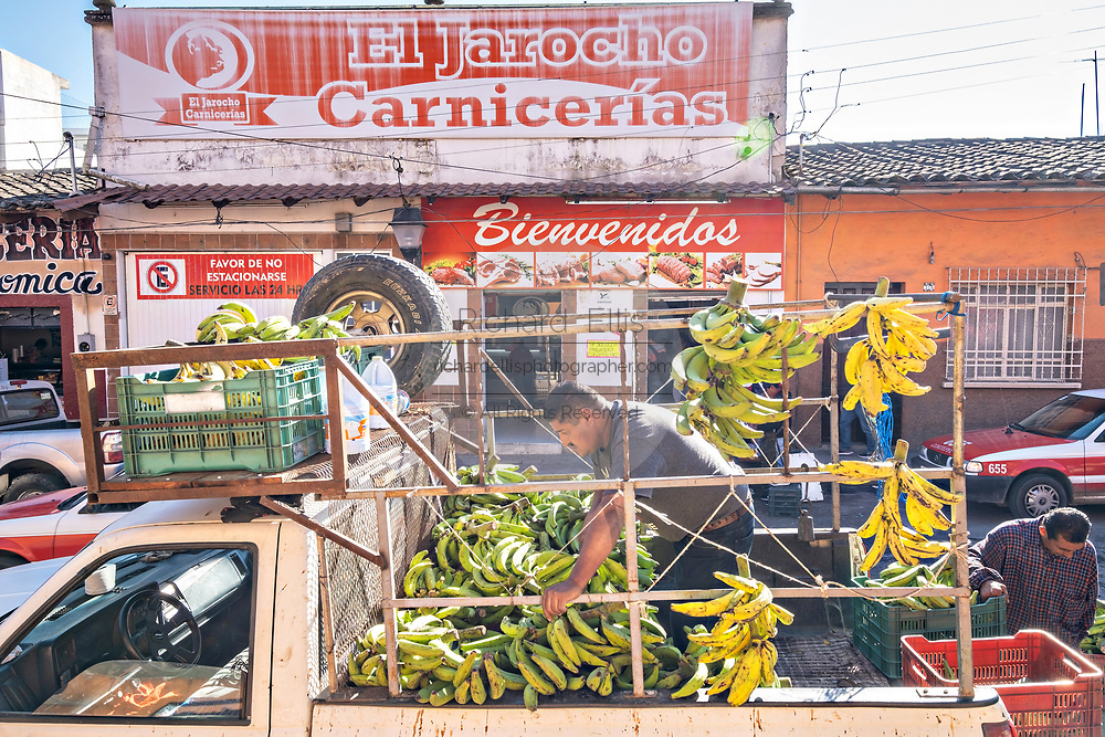 Farmers unload fresh bananas at the at the Miguel Rebolledo market in the central historic district of Coatepec, Veracruz State, Mexico.