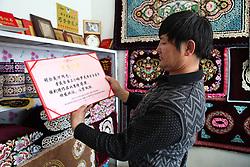 May 24, 2017 - China - Xinjiang, CHINA-May 23 2017: (EDITORIAL USE ONLY. CHINA OUT)..The Khazakstan man is good at making embroidery works in Balikun, northwest China's Xinjiang Uygur Autonomous Region. (Credit Image: © SIPA Asia via ZUMA Wire)