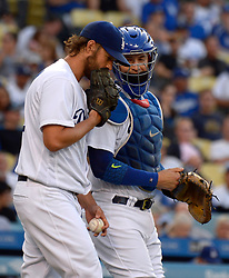 June 24, 2017 - Los Angeles, California, U.S. - Los Angeles Dodgers starting pitcher Clayton Kershaw talks with his catcher Yasmani Grandal against the Colorado Rockies in the first inning of a Major League baseball game at Dodger Stadium on Saturday, June 24, 2017 in Los Angeles. Los Angeles. (Photo by Keith Birmingham, Pasadena Star-News/SCNG) (Credit Image: © San Gabriel Valley Tribune via ZUMA Wire)
